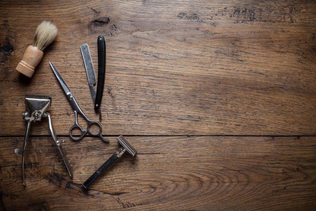 shaving tools on dark wood