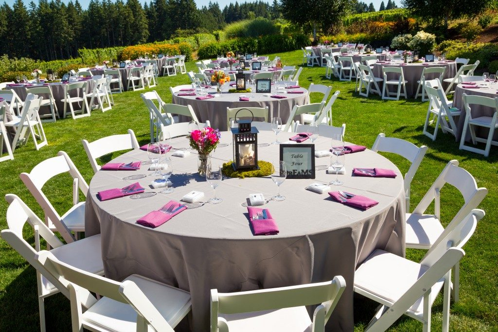 Tables, chairs, decor, and decorations at a wedding reception at an outdoor venue vineyard winery in oregon