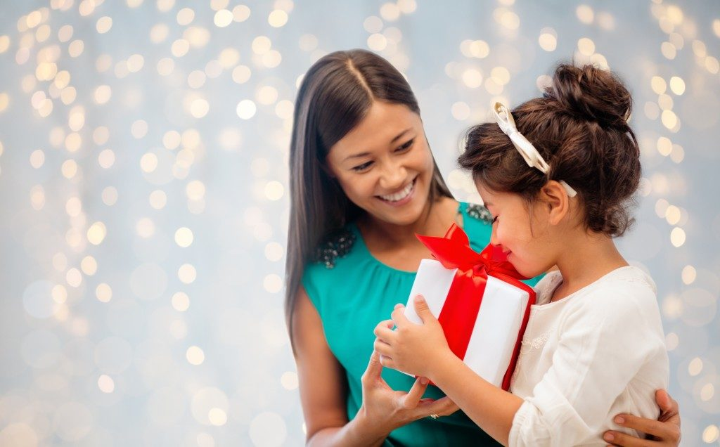 mother giving her daughter a present