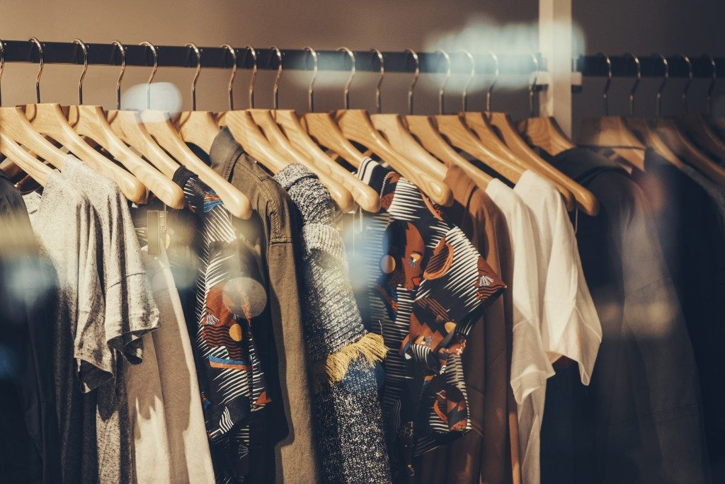 dresses and blouse hanged on closet rack