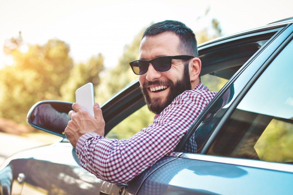 man in car wearing sunglasses