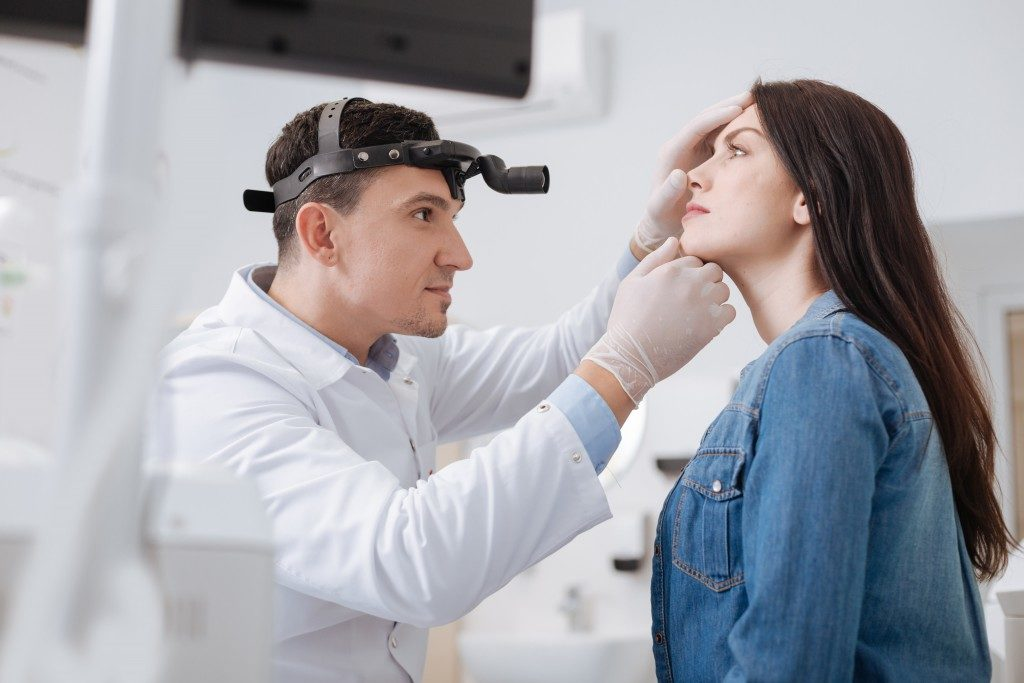 ent doector examining her patient