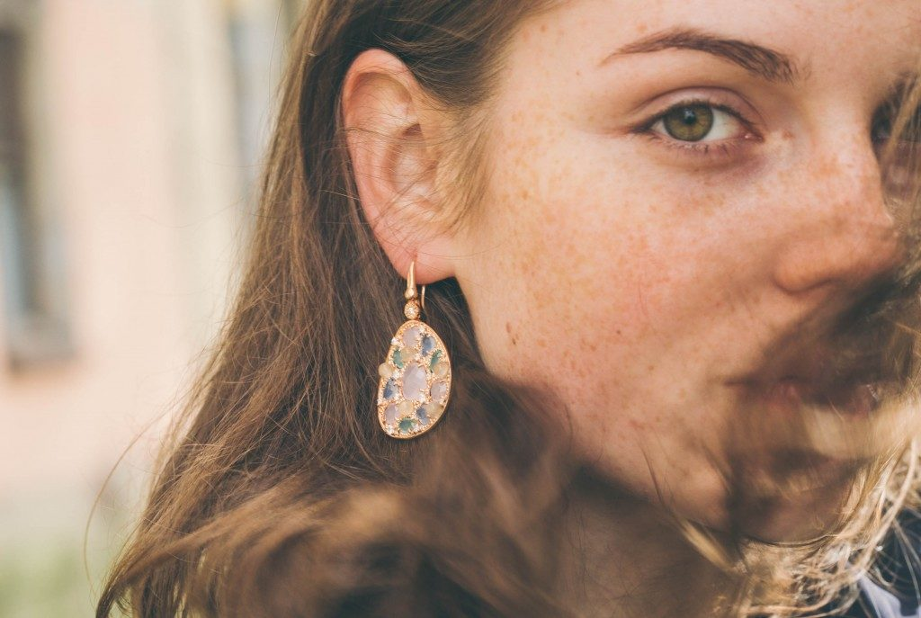 woman wearing a vintage earring