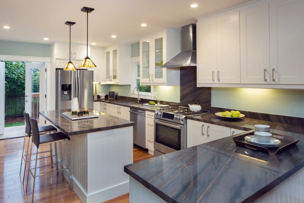 New decorated white Kitchen in luxury home with black granite counter top
