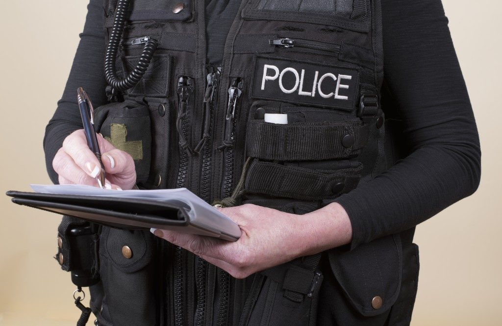 police writing report and geared up