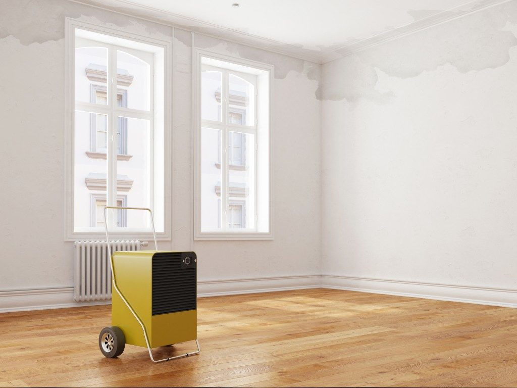 Professional dehumidifier after water damage standing in a room