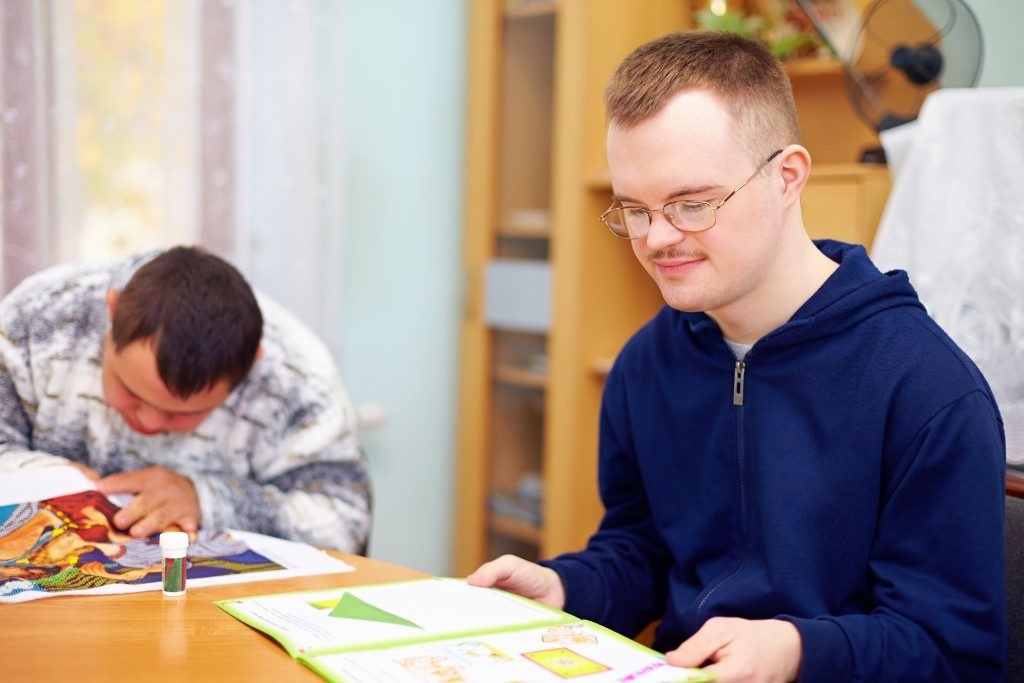 people with disabilities studying in a room