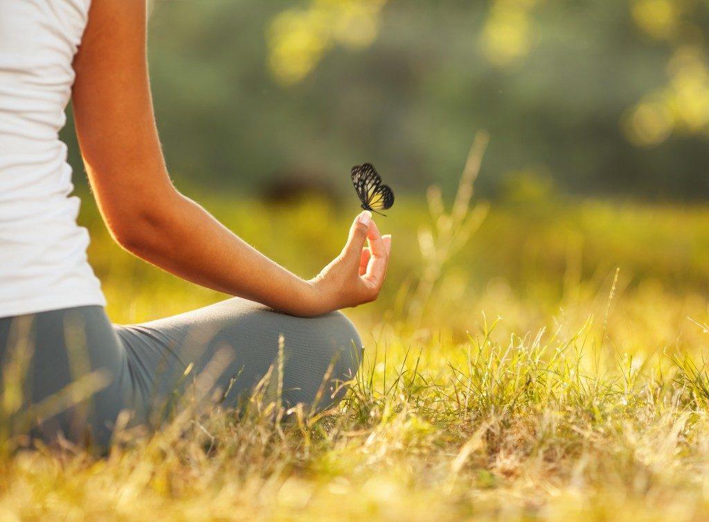 meditating on a field