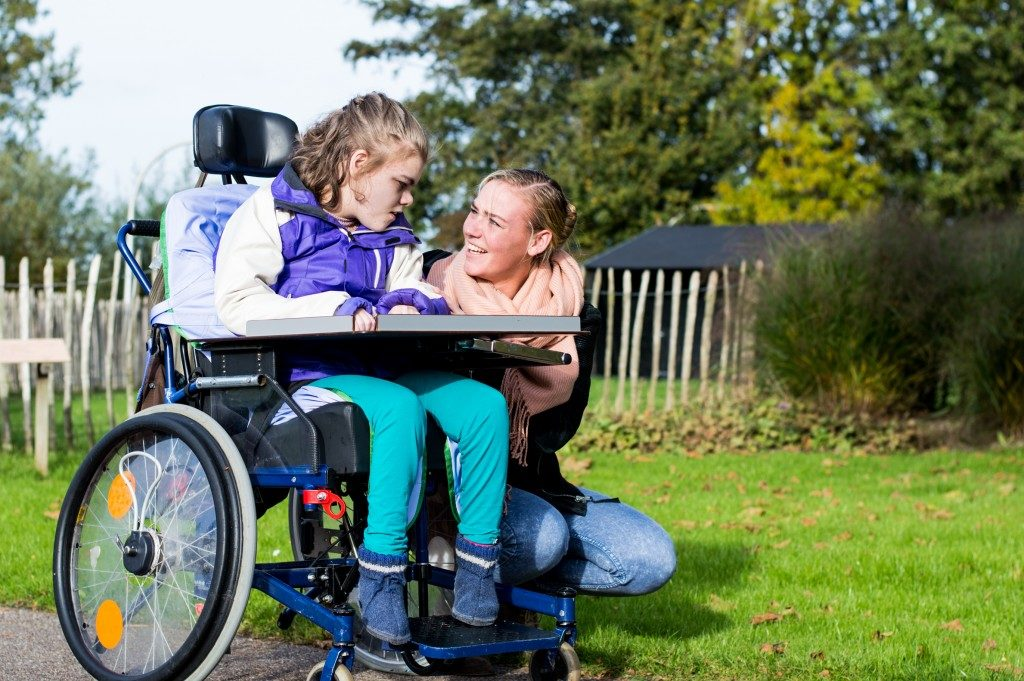 mother with her child in wheelchair