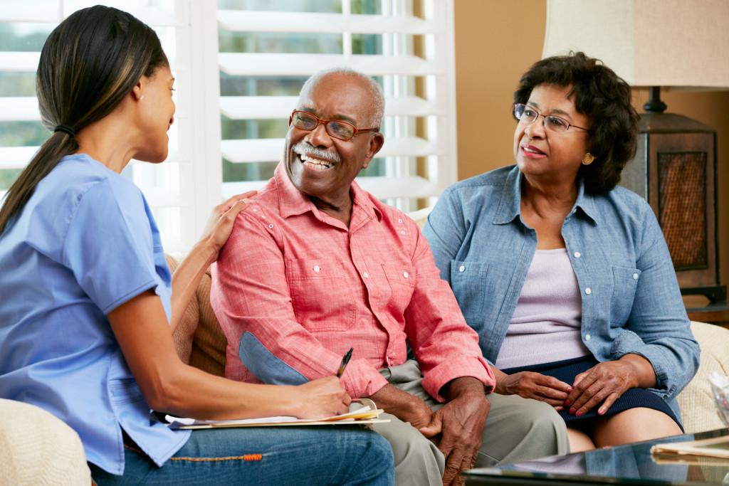 nurse caring for a senior man