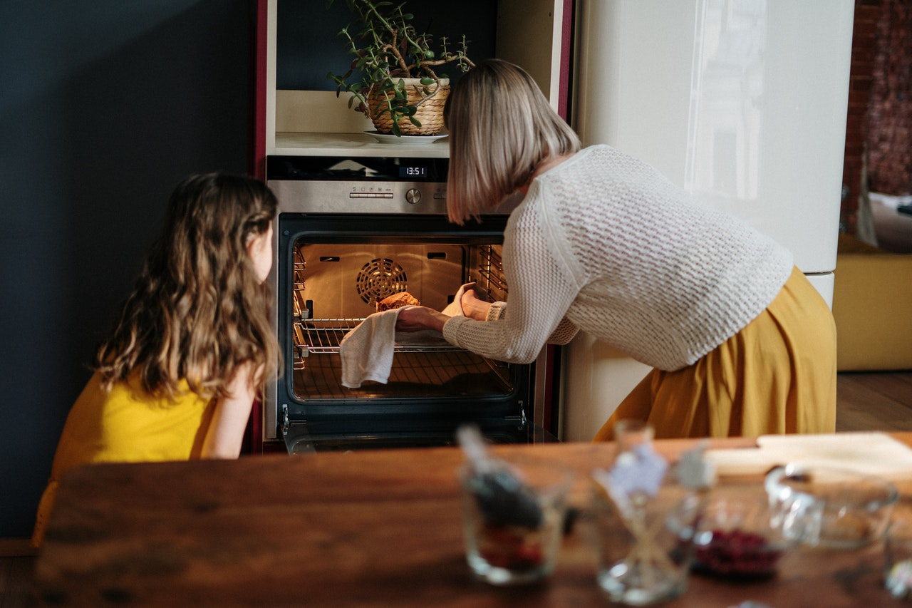 mom and kid cooking