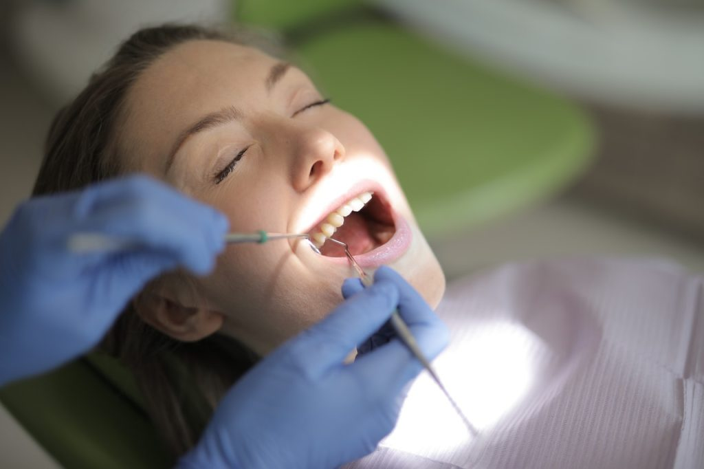 woman getting her teeth checked