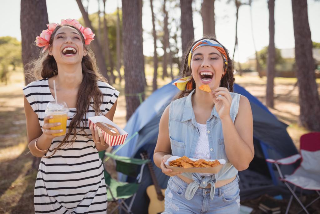 women eating snacks