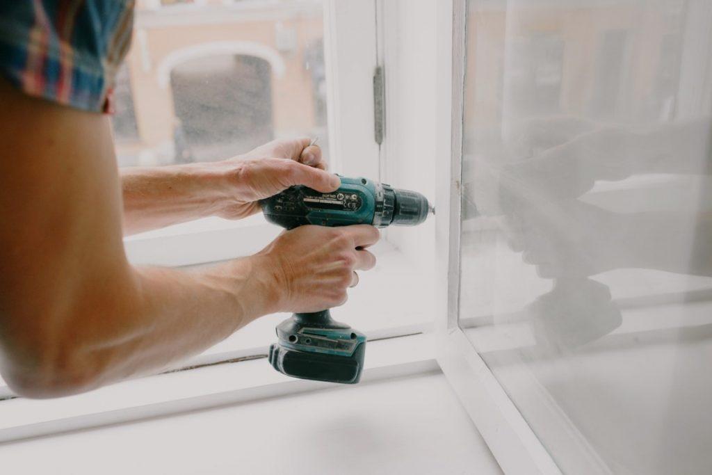 man using a drill