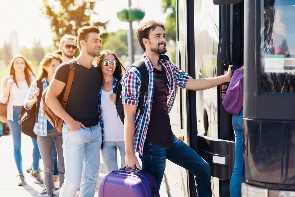 man boarding bus