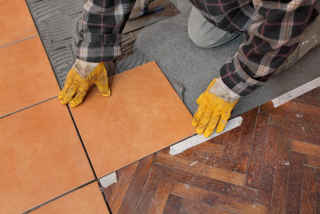 man preparing tiles