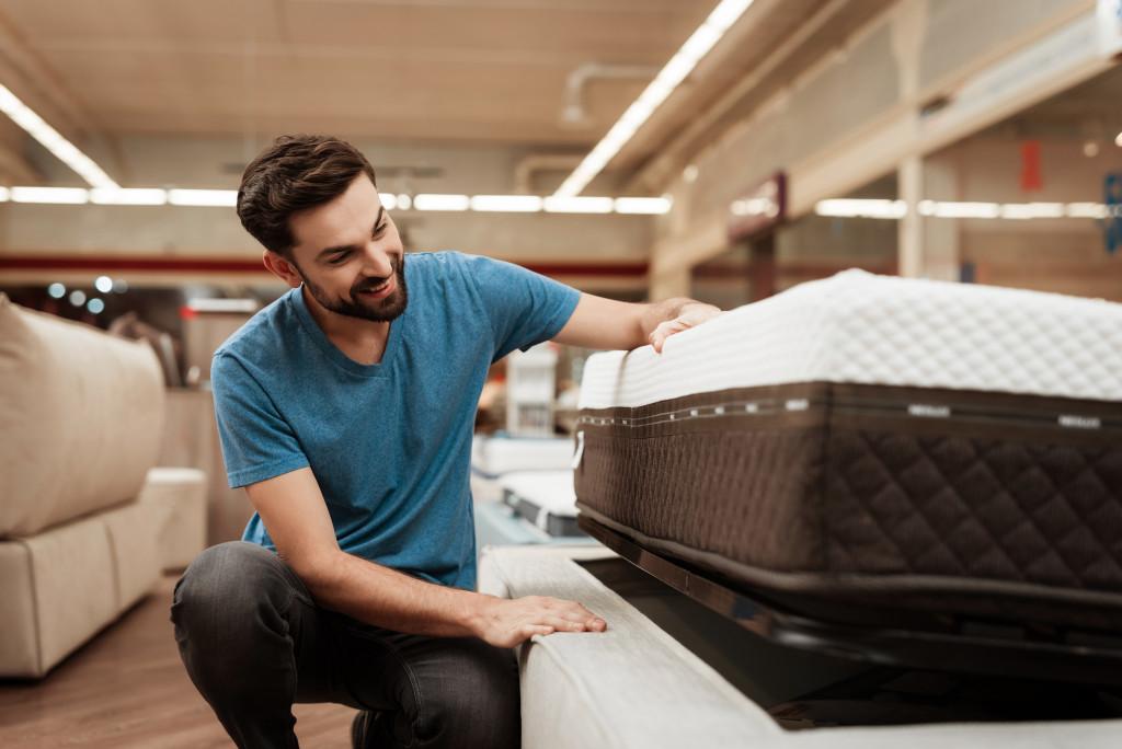 man shopping for a mattress