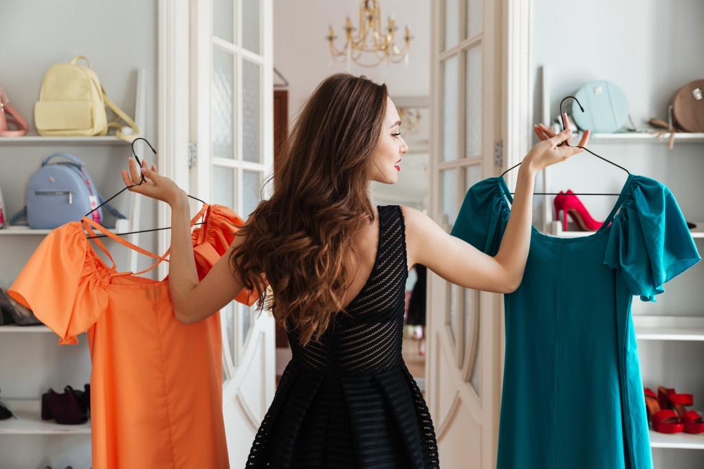 woman choosing between clothes