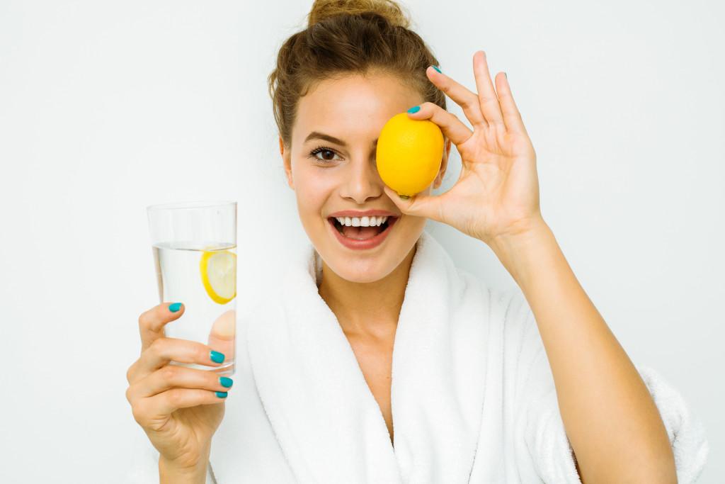 wearing a robe and having lemon water