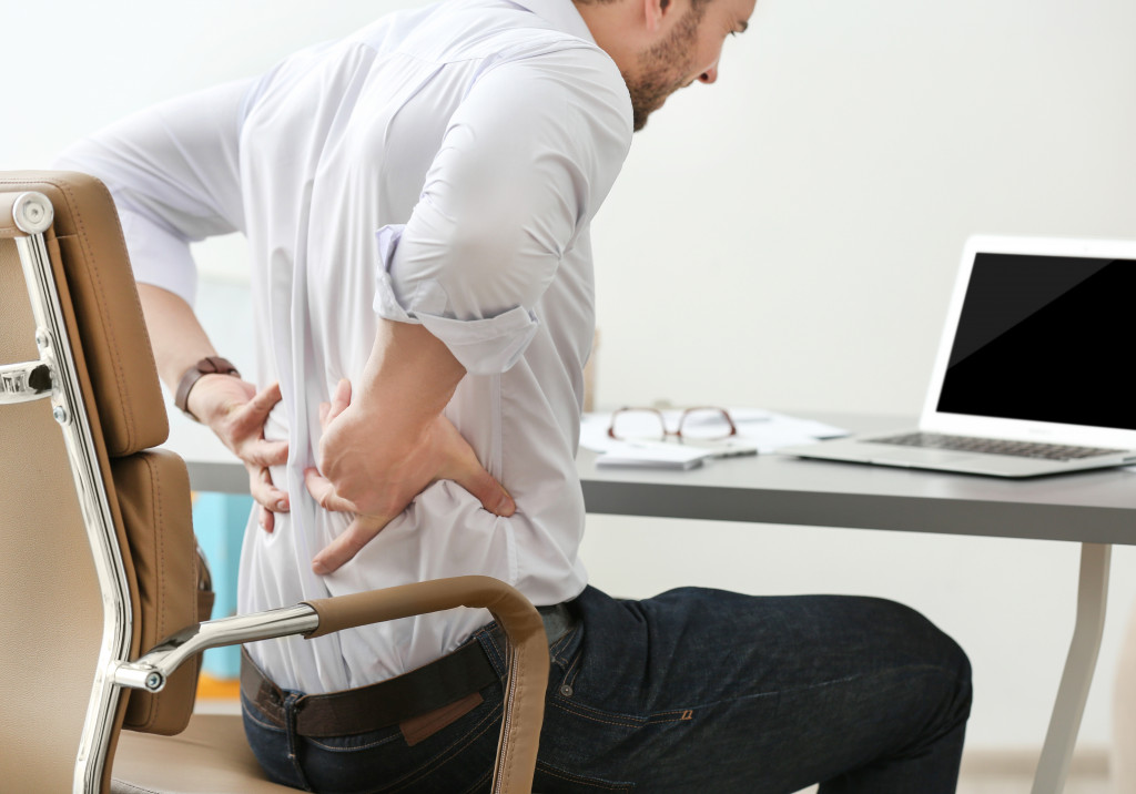 person having back pain