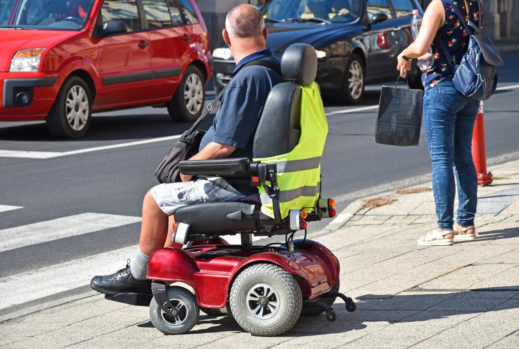 senior on powered wheel chair