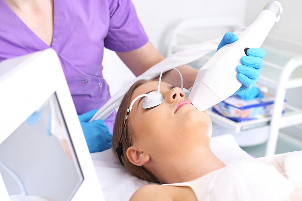 woman receiving laser skin treatment