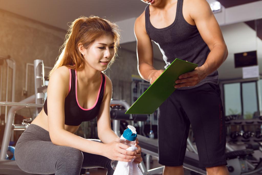 women with gym coach